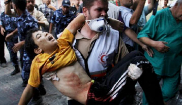 Palestinian medic carries wounded child